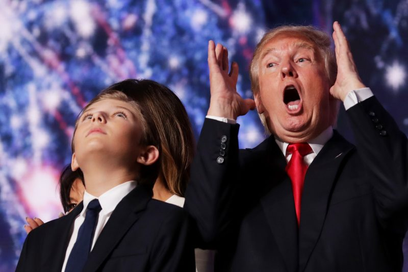 CLEVELAND, OH - JULY 21:  Republican presidential candidate Donald Trump reacts as his son Barron Trump looks on at the end of the Republican National Convention on July 21, 2016 at the Quicken Loans Arena in Cleveland, Ohio. Republican presidential candidate Donald Trump received the number of votes needed to secure the party's nomination. An estimated 50,000 people are expected in Cleveland, including hundreds of protesters and members of the media. The four-day Republican National Convention kicked off on July 18.  (Photo by Chip Somodevilla/Getty Images)