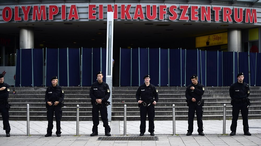 MUNICH, GERMANY - JULY 23: Police forces guard the crime scene outside the OEZ shopping center and the McDonalds the day after a shooting spree left nine victims dead on July 23, 2016 in Munich, Germany. According to police an 18-year-old German man of Iranian descent shot nine people dead and wounded at least 16 before he shot himself in a nearby park. For hours during the spree and the following manhunt the city lay paralyzed as police ordered people to stay off the streets. Original reports of up to three attackers seem to have been unfounded. The shooter's motive is so far unclear. (Photo by Alexander Koerner/Getty Images)