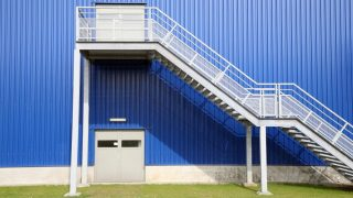 Blue Depot factory with green grass