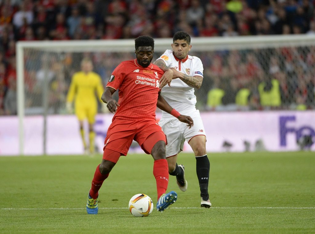 BASEL, SWITZERLAND - MAY 18:  Kolo Toure (L) of Liverpool with Ever Banega of Sevilla during the UEFA Europa League Final match between Liverpool and Sevilla at St. Jakob-Park on May 18, 2016 in Basel, Basel-Stadt. Sevilla won the match 3-1. (Photo by Bob Thomas/Popperfoto/Getty Images).