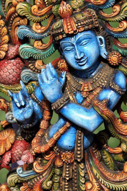 13187406 - wooden statue of lord krishna