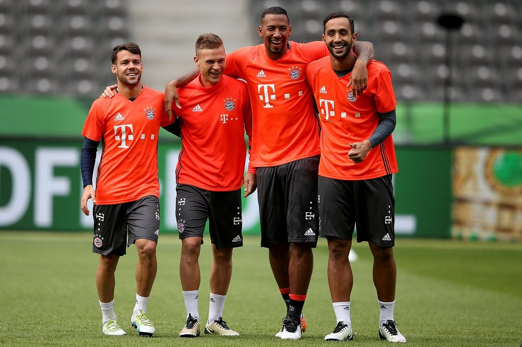 BERLIN, GERMANY - MAY 20:  Juan Bernat, Joshua Kimmich, Jerome Boateng and Mehdi Benatia look on during the Bayern Muenchen final training session ahead of the DFB Cup Final 2016 at Olympiastadion on May 20, 2016 in Berlin, Germany.  (Photo by Lars Baron/Bongarts/Getty Images)