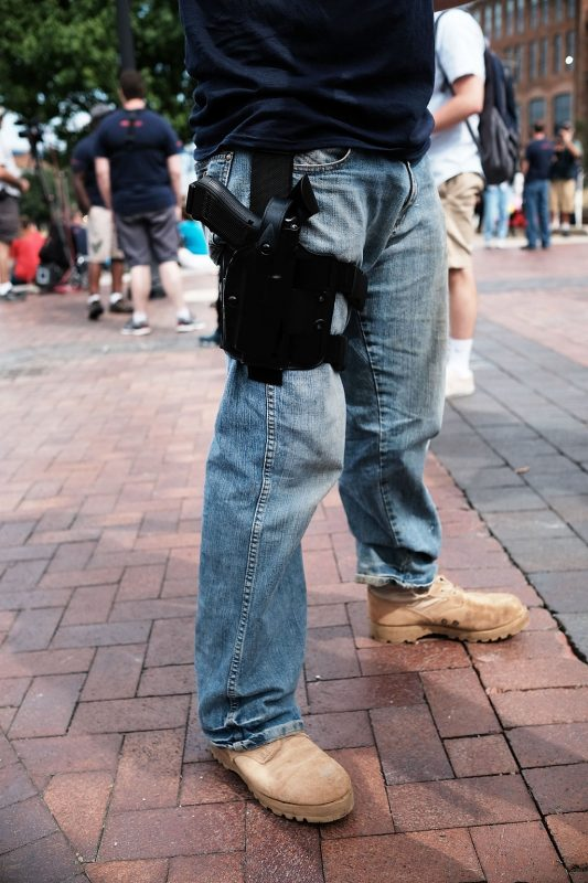 CLEVELAND, OH - JULY 18: A Trump supporter attends a rally with his pistol in downtown Cleveland in the first day of the Republican National Convention (RNC) on July 18, 2016 in Cleveland, Ohio. An estimated 50,000 people are expected in Cleveland, including hundreds of protesters and members of the media. The convention runs through July 21.   Spencer Platt/Getty Images/AFP / AFP PHOTO / GETTY IMAGES NORTH AMERICA / SPENCER PLATT