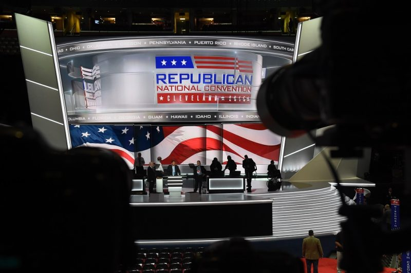 Workers prepare the stage before the opening of the Republican National Convention on July 18, 2016 in Cleveland, Ohio. Thousands of delegates descend on a tightly secured Cleveland arena for the opening of the Republican National Convention, with Donald Trump's wife playing character witness as the tough-talking mogul seeks to lock up his party's presidential nomination. / AFP PHOTO / Robyn BECK