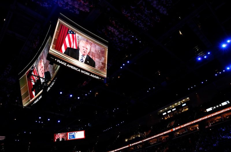 CLEVELAND, OH - JULY 19:  Republican presidential candidate Donald Trump is seen speaking on a screen from New York City, on the second day of the Republican National Convention on July 19, 2016 at the Quicken Loans Arena in Cleveland, Ohio. Republican presidential candidate Donald Trump received the number of votes needed to secure the party's nomination. An estimated 50,000 people are expected in Cleveland, including hundreds of protesters and members of the media. The four-day Republican National Convention kicked off on July 18.  (Photo by Win McNamee/Getty Images)
