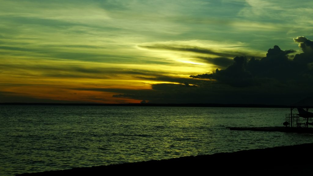 Colorful sunset over the Rio Negro in Amazonas.