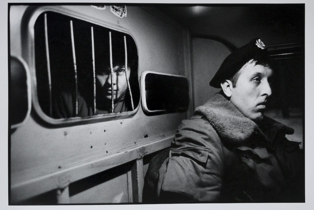 A drunk in the back of a police van.