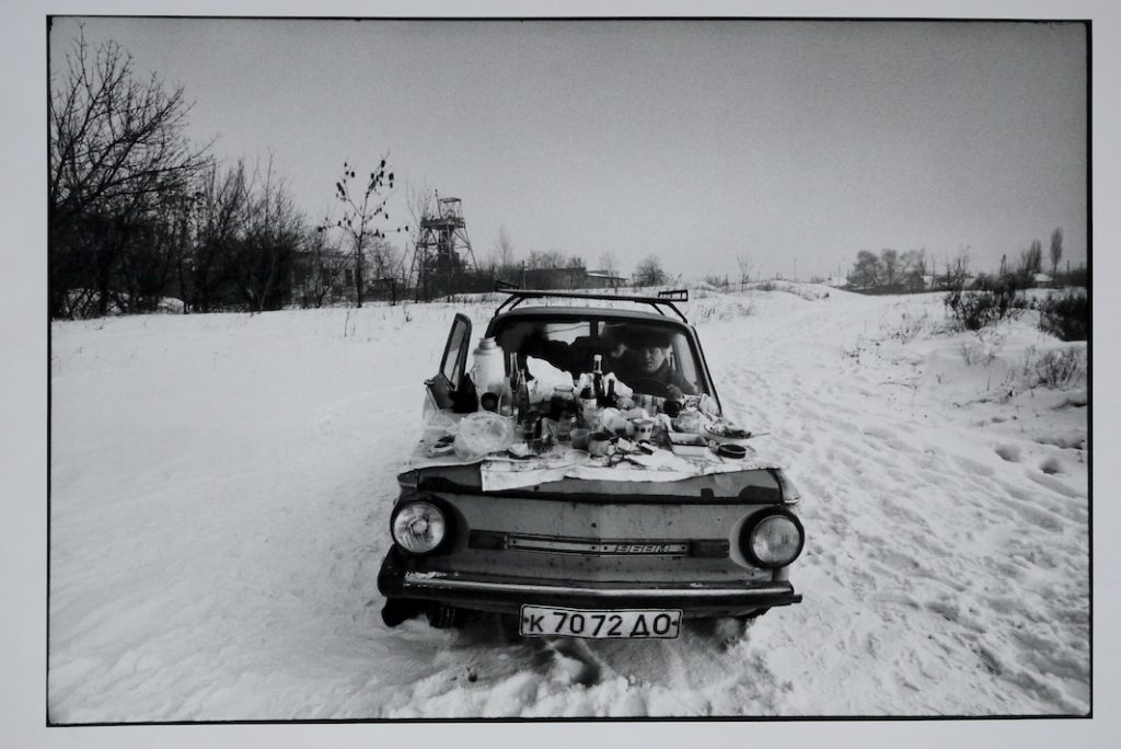 A family sit's in their car to keep warm on New Years Day 1992.  Their car is know to local's as 'The coffin on wheels' The temperature outside was -15C. Donetsk, Ukraine.