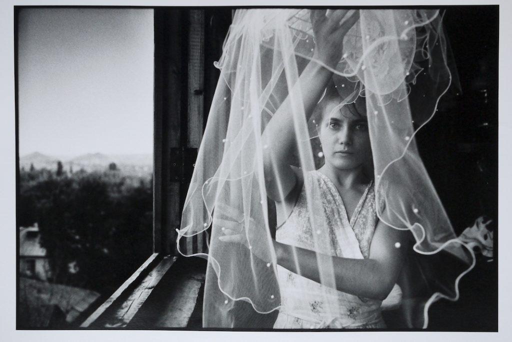 Irina Slakar preparing her veil on her wedding day.  She is marrying Demitri, a former miner at the Socialist Donbass coal mine. Donetsk, Ukraine.