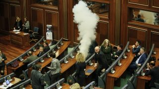 Opposition lawmakers release a tear gas device in the Kosovo's parliament in Pristina, March 10, 016, in the latest eruption of a long-running protest against agreements made with Serbia.  Kosovo government reached a deal with Serbia in 2015 to grant more powers to the Serb minority. Opposition fears the plan will deepen Kosovo's ethnic division and increase the influence of Serbia. / AFP PHOTO / STR