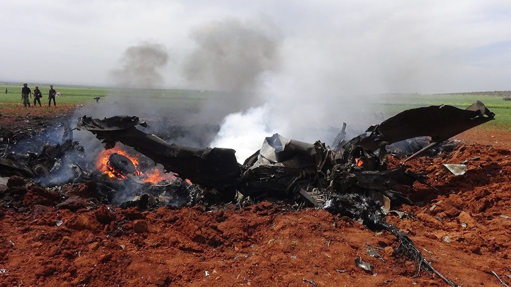 A general view shows the wreckage of a government warplane after Al-Nusra front (Al-Qaeda's Syria affiliate) repotedly shot it down over the northern Syrian town of Al-Eis on April 5, 2016 and captured one crew member alive, a rebel source and the Syrian Observatory for Human Rights said.                           The monitoring group said Al-Nusra downed the plane, which it said was likely being flown by a Syrian air force pilot. / AFP PHOTO / OMAR HAJ KADOUR