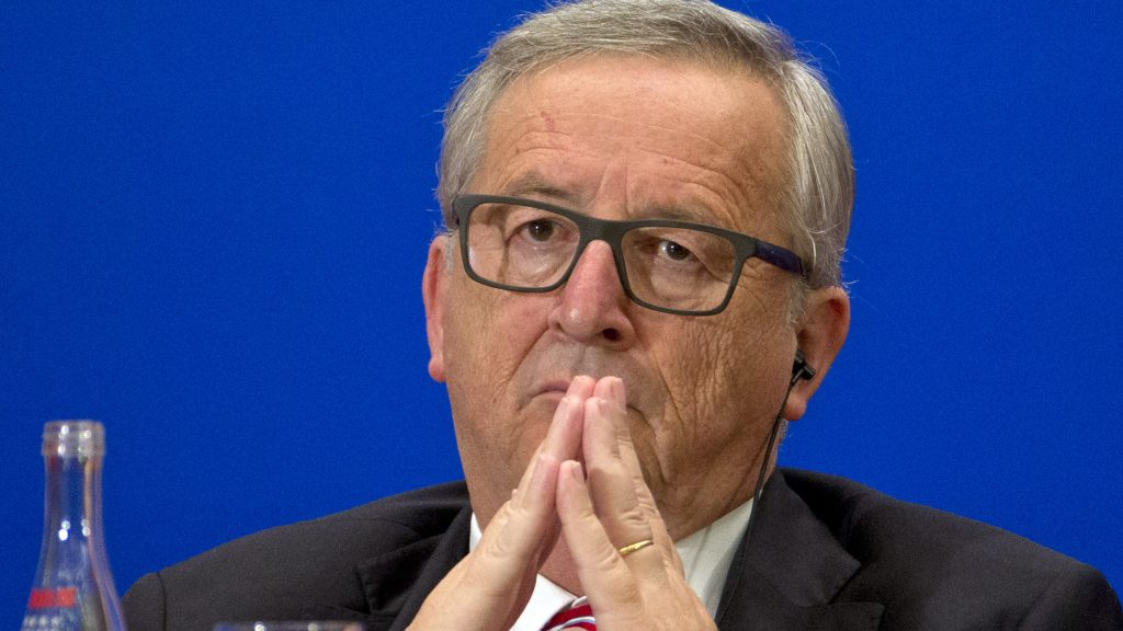 European Commission President Jean-Claude Juncker listens during to a speech at the 11th EU-China Business Summit at the Great Hall of the People in Beijing on July 13, 2016. The 18th bilateral summit between the EU and China is being held in Beijing from July 12 to 13. / AFP PHOTO / POOL / Ng Han Guan