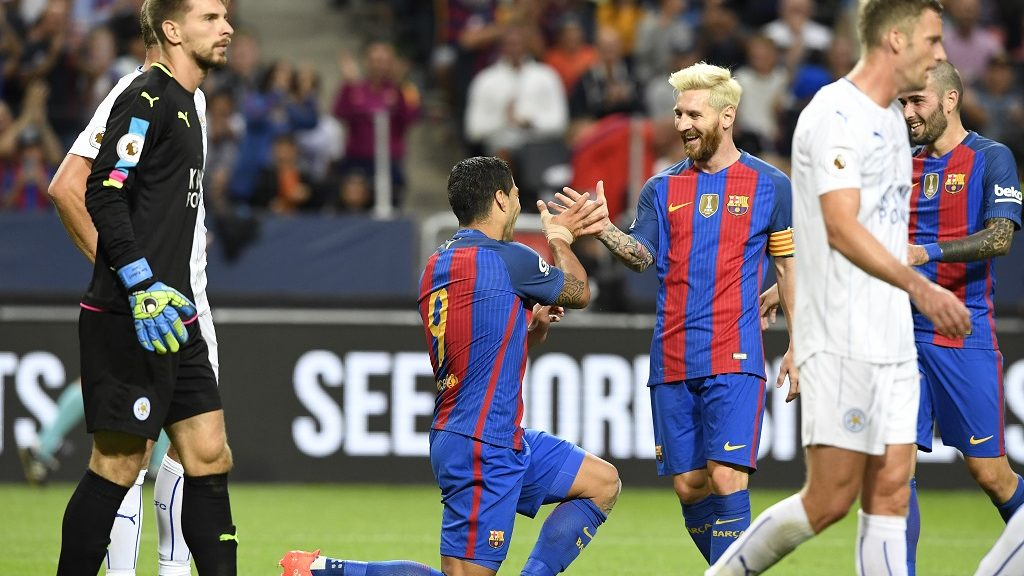 Barcelona's Uruguayan forward Luis Suarez (2nd L) celebrates with his teammate Argentinian forward Lionel Messi after scoring a goal during the 2016 International Champions Cup football match between FC Barcelona and Leicester City at Friends Arena on August 3, 2016 in Solna, Sweden. / AFP PHOTO / JONATHAN NACKSTRAND