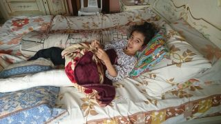 """A handout picture taken on by a family member and released by human rights organisation Amnesty International on August 13, 2016 shows Syrian girl Ghina Ahmad Wadi resting at her home in the Syrian city of Madaya on August 8, 2016 after being shot in the leg according to Amnesty International.  Human rights group Amnesty International called on August 13, 2016 for the evacuation of a ten-year-old Syrian girl shot in the leg by a government sniper in the besieged town of Madaya, according to Amnesty. Ghina Ahmad Wadi was hit at a checkpoint in the southwestern town eleven days ago while buying medicine for her mother, according to Amnesty. Amnesty is now urging the UN humanitarian task force in Syria, which is headed by US and Russian authorities, to evacuate her. Its petition has reached more than 5,000 signatures.  / AFP PHOTO / Amnesty International / FAMILY HANDOUT / RESTRICTED TO EDITORIAL USE - MANDATORY CREDIT  """" AFP PHOTO / AMNESTY INTERNATIONAL """"  -  NO MARKETING NO ADVERTISING CAMPAIGNS   -   DISTRIBUTED AS A SERVICE TO CLIENTS  / """"The erroneous mention[s] appearing in the metadata of this photo by FAMILY HANDOUT has been modified in AFP systems in the following manner:  ADDING RESTRICTIONS:   RESTRICTED TO EDITORIAL USE - MANDATORY CREDIT  """" AFP PHOTO / AMNESTY INTERNATIONAL """"  -  NO MARKETING NO ADVERTISING CAMPAIGNS   -   DISTRIBUTED AS A SERVICE TO CLIENTS   Please immediately remove the erroneous mention[s] from all your online services and delete it (them) from your servers. If you have been authorized by AFP to distribute it (them) to third parties, please ensure that the same actions are carried out by them. Failure to promptly comply with these instructions will entail liability on your part for any continued or post notification usage. Therefore we thank you very much for all your attention and prompt action. We are sorry for the inconvenience this notification may cause and remain at your disposal for any further information you may require."""""""