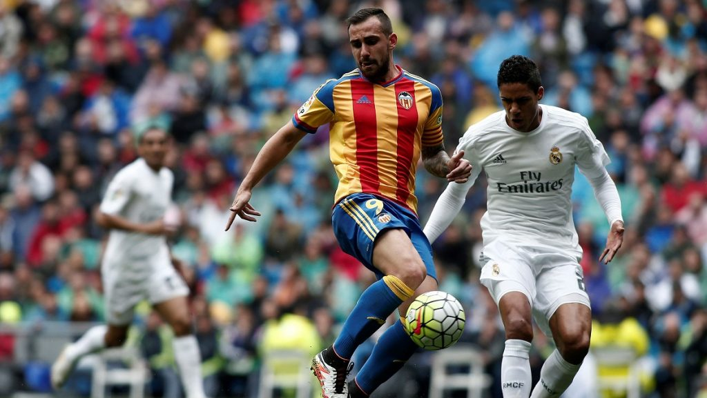 MADRID, SPAIN - MAY 8: Paco Alcacer (L) of Valencia in action against Raphael Varane (R) of Real Madrid during the Spanish La Liga match between Real Madrid and Valencia at Santiago Bernabeu stadium in Madrid, Spain on May 8, 2016. Burak Akbulut / Anadolu Agency