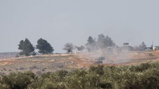 KILIS, TURKEY - FEBRUARY 15: A picture taken from Turkish side of Syrian border shows that Turkish Army howitzers shell YPG terrorists' targets which has been placed in the Azaz Town of Syria's Aleppo, from an emplacement near Syrian border in Turkey's Kilis province on February 15, 2016. YPG is the armed wing of PYD. The PYD terrorist organization is affiliated to the PKK, a terrorist organization which has fought Turkey since 1984 in a conflict that has caused more than 40,000 deaths. The PKK is listed as a terrorist organization by Turkey, the U.S. and EU. Orhan Cicek / Anadolu Agency