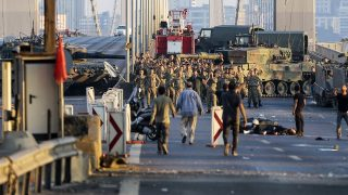 ISTANBUL, TURKEY - JULY 16: Soldiers involved in the coup attempt surrender on Bosphorus bridge with their hands raised on July 16, 2016  in Istanbul, Turkey. Istanbul's bridges across the Bosphorus, the strait separating the European and Asian sides of the city, have been closed to traffic. Turkish President Recep Tayyip Erdogan has denounced an army coup attempt, that has left atleast 90 dead 1154 injured in overnight clashes in Istanbul and Ankara. (Photo by Stringer/Getty Images)