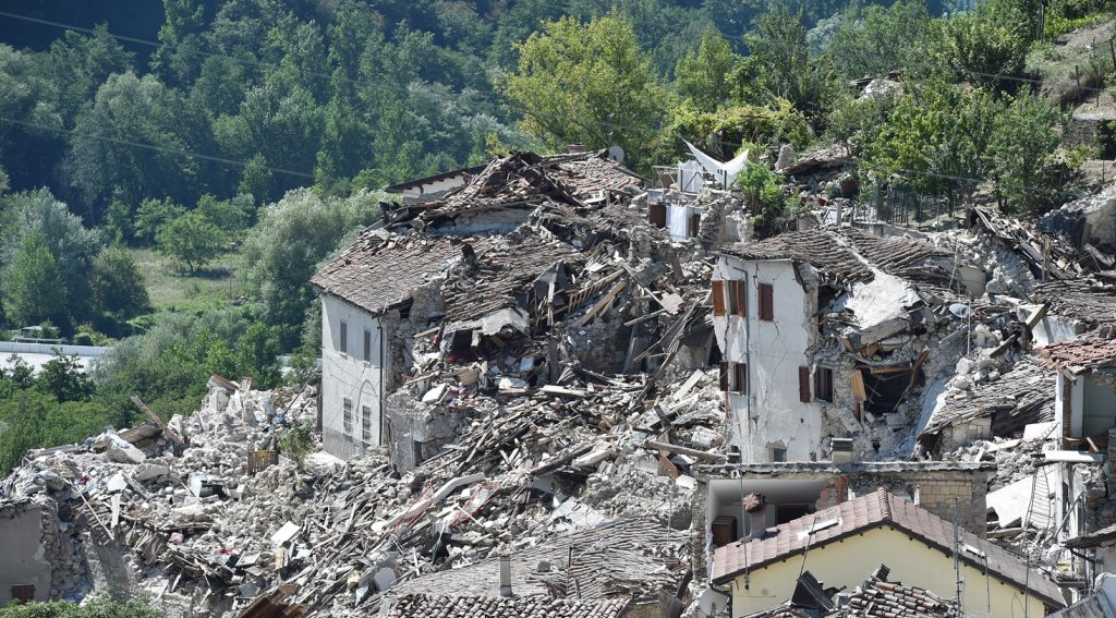 PESCARA DEL TRONTO, ITALY - AUGUST 25:  Rubble surrounds damaged buildings on August 25, 2016 in Pescara del Tronto, Italy. The death toll in the 6.2 magnitude earthquake that struck around the Umbria region of Italy in the early hours of Wednesday morning has risen to at least 247 as thousands of rescuers continue to search for survivors.  (Photo by Giuseppe Bellini/Getty Images)