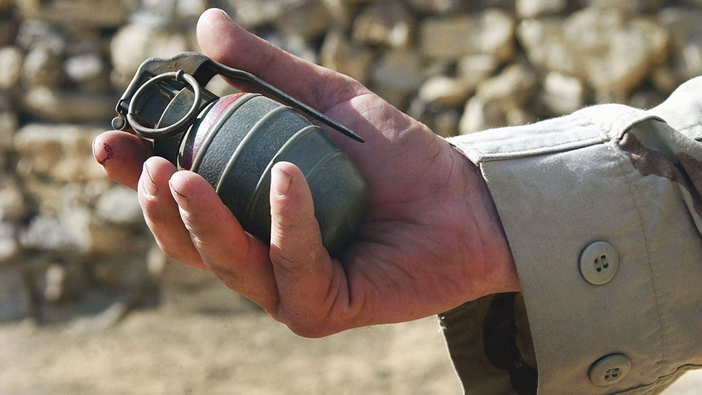 A close up view of an Arges Type HG-84 fragmentation grenade found by US Army (USA) Soldiers assigned to Bravo Company, 3-505th Infantry Battalion, 82nd Airborne Division, during a Sensitive Site Exploration mission conducted in a local village located outside Khowst, Afghanistan, during Exercise Alamo Sweep.