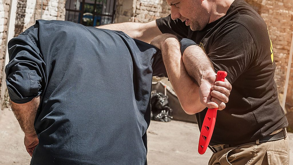 Kapap instructor demonstrates self defense techniques against a knife attack