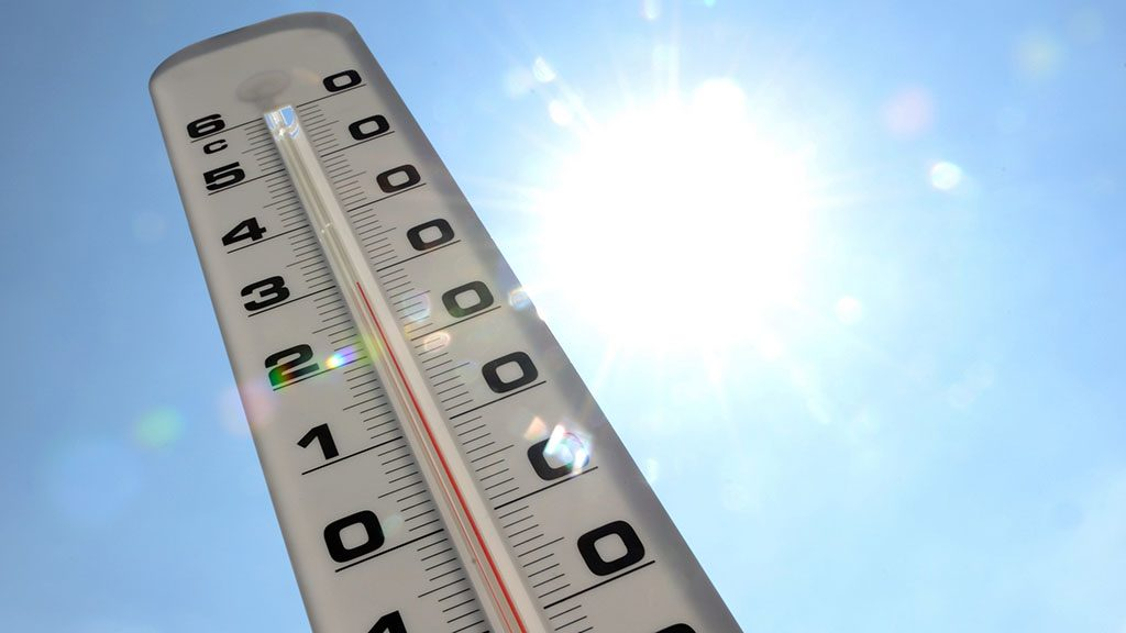 A thermometer shows the temperature rising up to 30 degrees Celcius on a warm sunny day on July 19, 2013 in Lille, northern France. AFP PHOTO / DENIS CHARLET / AFP PHOTO / DENIS CHARLET