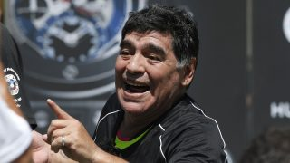 Former Argentinian football international Diego Maradona reacts during a football match organised by Swiss luxury watchmaker Hublot at the Jardin du Palais Royal in Paris on June 9, 2016, on the eve of the Euro 2016 European football championships. / AFP PHOTO / PATRICK KOVARIK
