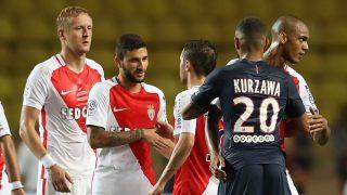 Paris Saint-Germain's French defender Layvin Kurzawa (R) react after the French Ligue 1 football match Monaco (ASM) versus Paris-Saint-Germain (PSG) on August 28, 2016 at the Louis II Stadium in Monaco.   / AFP PHOTO / VALERY HACHE