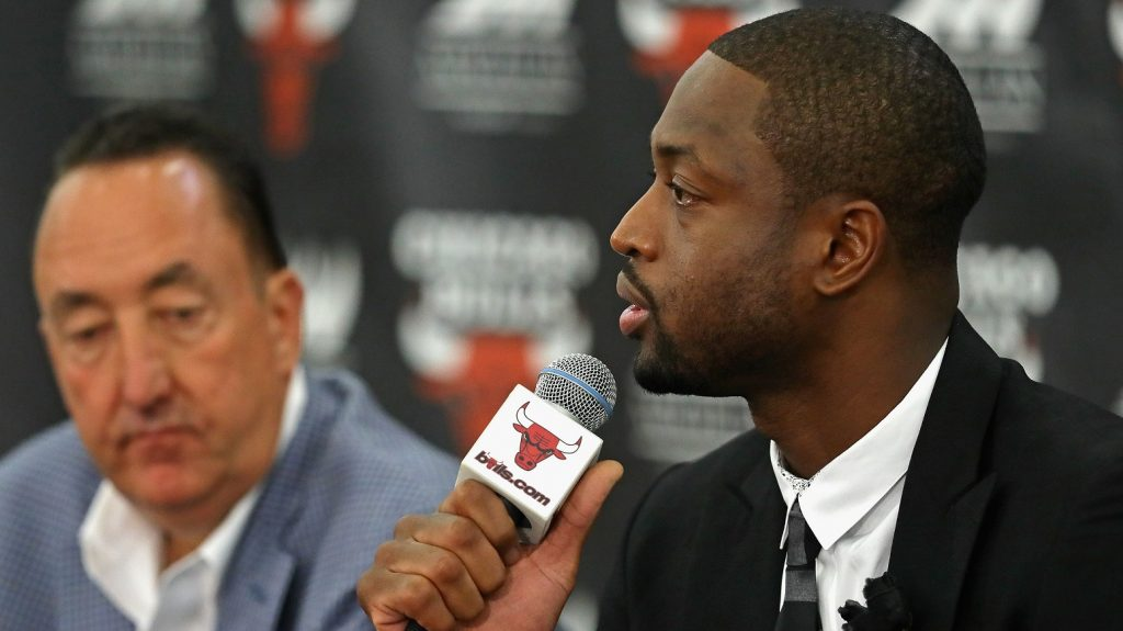 CHICAGO, IL - JULY 29: General manager Gar Forman of the Chicago Bulls (L) listens as Dwyane Wade speaks during an introductory press conference at the Advocate Center on July 29, 2016 in Chicago, Illinois.   Jonathan Daniel/Getty Images/AFP / AFP PHOTO / GETTY IMAGES NORTH AMERICA / JONATHAN DANIEL