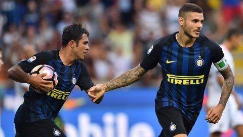 """Inter Milan's forward from Argentina Mauro Icardi (R) celebrates after scoring a goal next to Inter Milan's midfielder from Argentina Ever Banega during the Italian Serie A football match Inter Milan vs Palermo at """"San Siro"""" Stadium in Milan on August 28, 2016.  / AFP PHOTO / GIUSEPPE CACACE"""