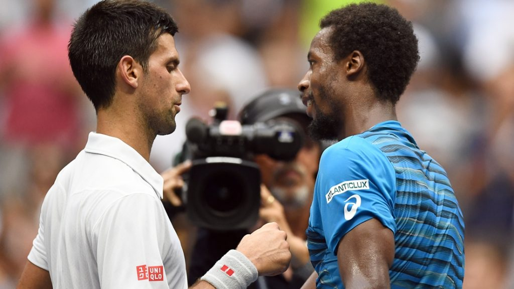 Novak Djokovic (L) of Serbia is congratulated by Gael Monfils of France at the end of their 2016 US Open Men's Singles semifinal match at the USTA Billie Jean King National Tennis Center in New York on September 9, 2016. / AFP PHOTO / Jewel SAMAD