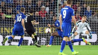 Chelsea's Spanish midfielder Cesc Fabregas (2nd L) shoots to score past Leicester City's Wes Morgan (C back) during extra-time in the English League Cup third round football match between Leicester City and Chelsea at King Power Stadium in Leicester, central England on September 20, 2016. / AFP PHOTO / ANTHONY DEVLIN / RESTRICTED TO EDITORIAL USE. No use with unauthorized audio, video, data, fixture lists, club/league logos or 'live' services. Online in-match use limited to 75 images, no video emulation. No use in betting, games or single club/league/player publications.  /