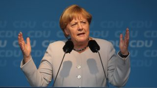 BERLIN, GERMANY - SEPTEMBER 14:  German Chancellor Angela Merkel, who is also Chairwoman of the German Christian Democrats (CDU), speaks to supporters at a CDU election campaign rally ahead of Berlin state elections on September 14, 2016 in Berlin, Germany. The city of Berlin, which is one of Germany's 16 states, or Bundeslaender, is scheduled to hold elections on September 18. So far the German Social Democrats (SPD) are leading ahead of the CDU and the Greens Party, while political newcomer the AfD (Alternative fuer Deutschland), a right-of-center populist party that has attracted far-right support, is sure to win parliament seats. Germany faces federal elections next year and so far Merkel has not said whether she will run for a third term.  (Photo by Sean Gallup/Getty Images)