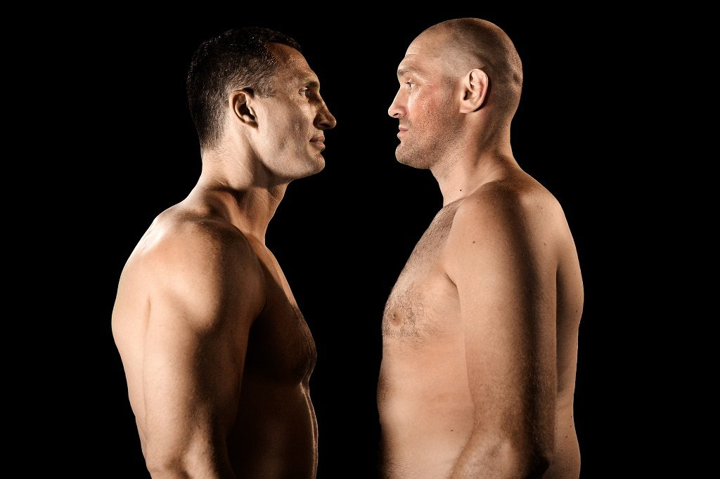 COLOGNE, GERMANY - APRIL 28:  (EXCLUSIVE COVERAGE) (L-R) Wladimir Klitschko and Tyson Fury face each other at Esprit-Arena on July 21, 2015 in Duesseldorf, Germany. Fury v Klitschko Part 2 will take place in Manchester on July 9 for the WBO, WBA and IBO heavyweight belts.  (Photo by Sascha Steinbach/Bongarts/Getty Images)