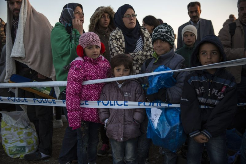 MORAHALOM, HUNGARY - SEPTEMBER 08:  Children who had crossed into Hungary from Serbia stand at a collection point awaiting buses to take them to a refugee camp at dawn on September 8, 2015 in Morahalom, Hungary. Thousands of migrants crossed into Hungary today from Serbia near Horgas. Since the beginning of 2015 the number of migrants using the so-called 'Balkans route' has exploded with migrants arriving in Greece from Turkey and then travelling on through Macedonia and Serbia before entering the EU via Hungary. The number of people leaving their homes in war torn countries such as Syria, marks the largest migration of people since World War II.  (Photo by Dan Kitwood/Getty Images)