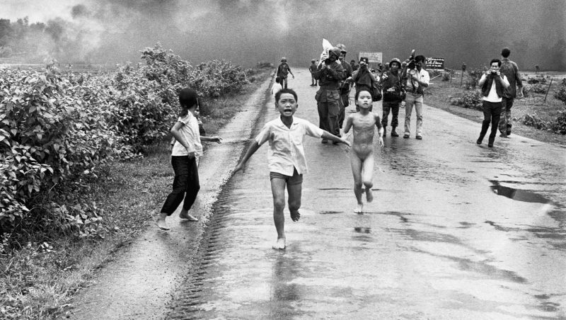 Vietnamese children flee from their homes in the South Vietnamese village of Trang Bang after South Vietnamese planes accidently dropped a napalm bomb on the village, located 26 miles outside of Saigon. Twenty-five years later, the young girl running naked from her village, Phan Thi Kim Phuc, was named UNESCO goodwill ambassador.