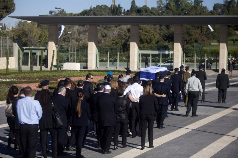JERUSALEM, ISRAEL - SEPTEMBER 30:  Family members of former Israeli President Shimon Peres follow his coffin at the Knesset, Israel's parliament, on September 30, 2016 in Jerusalem, Israel. World leaders and dignitaries from 70 countries will attend the state funeral of Israel's ninth president, Shimon Peres, in Jerusalem on Friday, after thousands of Israelis paid their last respects to the elder statesman who died on Wednesday.  (Photo by Lior Mizrahi/Getty Images)
