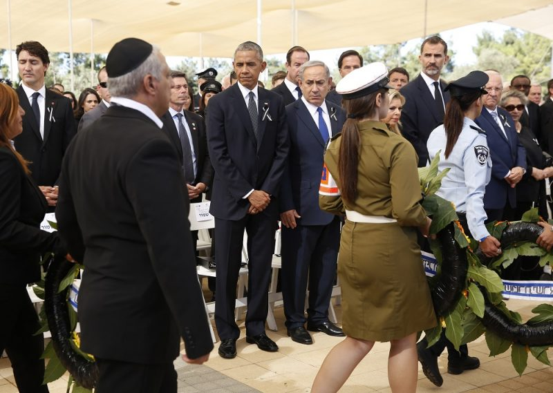 JERUSALEM, ISRAEL - SEPTEMBER 30:   U.S. President Barack Obama and Israeli Prime Minister Benjamin Netanyahu look on as Israeli military pass by with wreaths of flowers during the funeral of Shimon Peres at Mount Herzl Cemetery on September 30, 2016 in Jerusalem, Israel. World leaders and dignitaries from 70 countries attended tthe state funeral of Israel's ninth president, Shimon Peres, in Jerusalem on Friday, after thousands of Israelis paid their last respects to the elder statesman who died on Wednesday. (Photo by Abir Sultan- Pool/Getty Images)