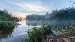 The morning fog on the river Ems disappears at sunrise near Warendorf, Germany, 21 September 2016. PHOTO: GUIDO KIRCHNER/dpa