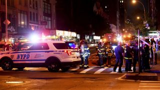 NEW YORK, NY - SEPTEMBER 17:  Police officers and firefighters respond to an explosion on September 17, 2016 at 23rd Street and 7th Avenue in the Chelsea neighborhood of New York City. According to reports, over 20 people have been taken to hospitals with injuries, none of which are thought to be life threatening. (Photo by Jamie McCarthy/Getty Images)