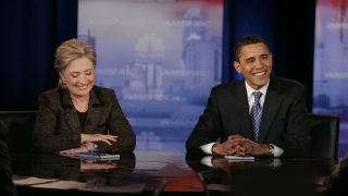 CLEVELAND - FEBRUARY 26:  Democratic presidential hopeful Sen. Hillary Clinton (D-NY) and Sen. Barack Obama (D-IL) smile as they participate in a debate at Cleveland State University's Wolstein Center February 26, 2008 in Cleveland, Ohio. Clinton and Obama will face off in the crucial Texas and Ohio primaries on March 4.  (Photo by J.D. Pooley/Getty Images)
