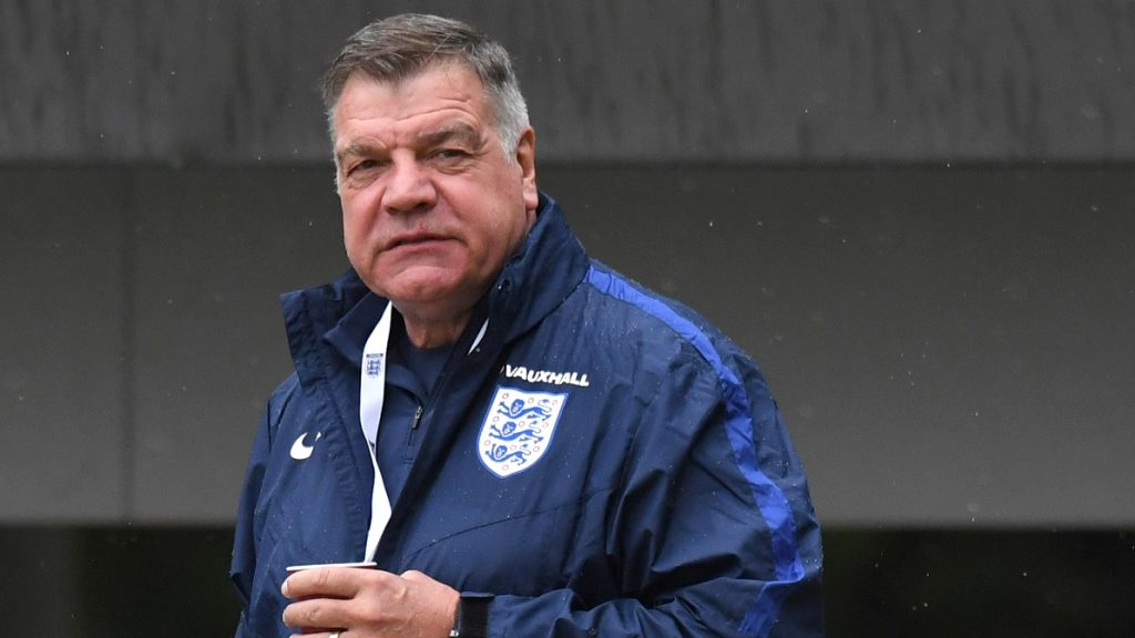 (FILES) This file photo taken on September 03, 2016 shows England manager Sam Allardyce arriving for a training session at St George's Park near Burton-Upon-Trent in central England on September 3, 2016. England manager Sam Allardyce has been secretly filmed giving advice on how to circumnavigate transfer rules and mocking his predecessor Roy Hodgson's voice, the Daily Telegraph reported on September 27, 2016. / AFP PHOTO / Anthony Devlin