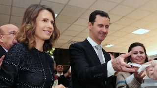 """A handout picture made available on the Syrian Presidency Facebook page on April 13, 2016 shows Syrian President Bashar al-Assad (C) and his wife Asma (L) voting at a polling station in Damascus during the parliamentary elections. Syrians went to the polls in areas controlled by Assad's regime for parliamentary elections dismissed by the opposition as illegitimate. Around 7,200 polling stations opened at 7:00 am (0400 GMT) in government-held areas -- around a third of the country's territory where about 60 percent of the population lives.      / AFP PHOTO / Syrian Presidency Facebook page / STRINGER / RESTRICTED TO EDITORIAL USE - MANDATORY CREDIT """"AFP PHOTO / SYRIAN PRESIDENCY FACEBOOK PAGE /STRINGER"""" - NO MARKETING NO ADVERTISING CAMPAIGNS - DISTRIBUTED AS A SERVICE TO CLIENTS"""