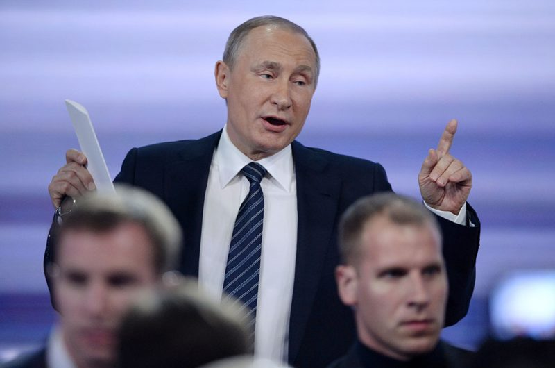 Russian President Vladimir Putin gestures as he leaves a hall after his annual press conference in Moscow on December 17, 2015. Russian President Vladimir Putin on December 17 described US Republican presidential hopeful Donald Trump as a talented and outstanding man. AFP PHOTO / NATALIA KOLESNIKOVA / AFP PHOTO / NATALIA KOLESNIKOVA
