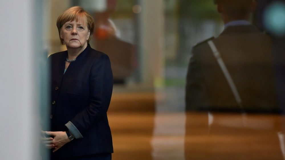 German Chancellor Angela Merkel awaits to welcome King Carl XVI Gustaf of Sweden and Queen Silvia of Sweden at the chancellory in Berlin on October 5, 2016. The royal couple of Sweden started their four-day visit to Germany. / AFP PHOTO / John MACDOUGALL