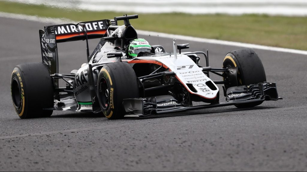 """Sahara Force India F1 Team's German driver Nico Hulkenberg drives during the Formula One Japanese Grand Prix race in Suzuka on October 9, 2016. / AFP PHOTO / BEHROUZ MEHRI / """"The erroneous mention[s] appearing in the metadata of this photo by BEHROUZ MEHRI has been modified in AFP systems in the following manner: [October 9] instead of [October 7]. Please immediately remove the erroneous mention[s] from all your online services and delete it (them) from your servers. If you have been authorized by AFP to distribute it (them) to third parties, please ensure that the same actions are carried out by them. Failure to promptly comply with these instructions will entail liability on your part for any continued or post notification usage. Therefore we thank you very much for all your attention and prompt action. We are sorry for the inconvenience this notification may cause and remain at your disposal for any further information you may require."""""""