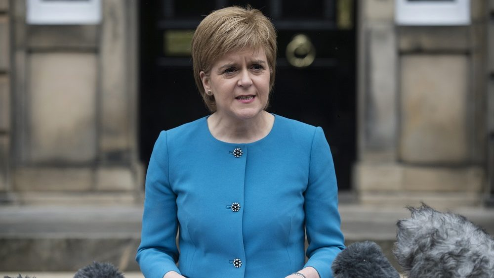 """(FILES) This file photo taken on June 25, 2016 shows  Scotland's First Minister and Leader of the Scottish National Party (SNP), Nicola Sturgeon, addresses the media outside Bute House in Edinburgh, Scotland. Scotland's government will publish a draft bill for an independence referendum next week as a last resort if it cannot keep close EU ties when Britain leaves the bloc, First Minister Nicola Sturgeon said on October 13, 2016. """"I can confirm today that the independence referendum bill will be published for consultation next week"""" in the Scottish parliament, Sturgeon told delegates at her Scottish National Party's annual conference. / AFP PHOTO / OLI SCARFF"""