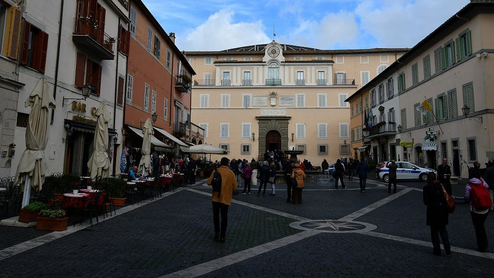 A photo taken on October 21, 2016 shows an exterior view of the Pontiff's private apartments, now open to tourists as a museum, at the former summer residence in Castel Gandolfo. Pope Francis has renounced the delights of Castel Gandolfo outside Rome and opened his private apartments to tourists, the Vatican said on October 21. Pope Francis has visited the palace 25 kilometres (15 miles) from Rome only a couple of times since his election in 2013, and has never spent the night there. Francis opened the estate's gardens to the public in 2014, since last year tourists have also been able to climb aboard a special white train for an express trip to the lavish estate and a tour of the papal villa, including the past pope's organic farm, which houses cows, free-range hens, cockerels and pontifical bees. / AFP PHOTO / ALBERTO PIZZOLI