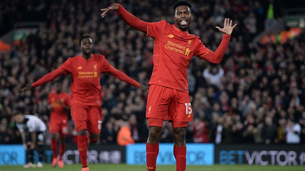 Liverpool's English striker Daniel Sturridge (R) celebrates after scoring their second goal during the EFL (English Football League) Cup fourth round match between Liverpool and Tottenham Hotspur at Anfield in Liverpool north west England on October 25, 2016. / AFP PHOTO / Oli SCARFF / RESTRICTED TO EDITORIAL USE. No use with unauthorized audio, video, data, fixture lists, club/league logos or 'live' services. Online in-match use limited to 75 images, no video emulation. No use in betting, games or single club/league/player publications.  /