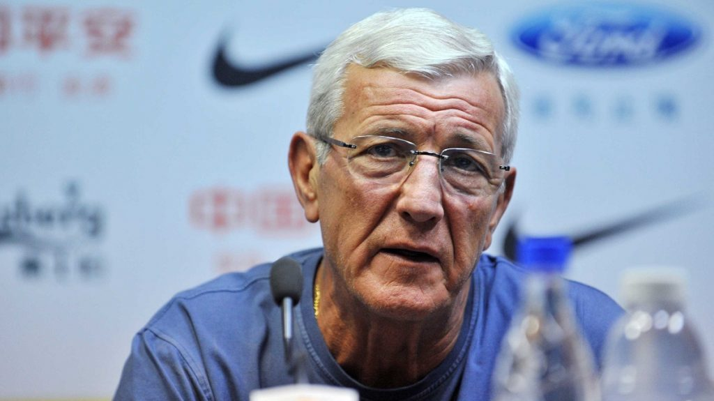 """--FILE--Head coach Marcello Lippi of China's Guangzhou Evergrande attends a press conference for their 29th round match during the 2014 Chinese Football Association Super League in Guangzhou city, south China's Guangdong province, 25 October 2014.  Former World Cup-winning coach Marcello Lippi is being tipped to take over as coach of China to replace Gao Hongbo, reports said Wednesday (19 October 2016). """"Lippi, coach of China,"""" ran the headline on the front page of Italy's second most popular sports daily Corriere dello Sport. It claimed the Italian maestro was """"inclined to accept the offer"""" and added: """"In the coming days, the former Italy coach will travel to Beijing to pore over the details of the Chinese football association's offer."""""""