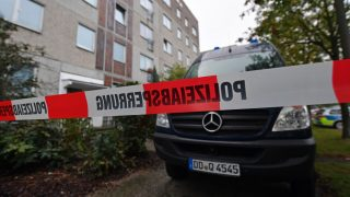A police barrier tape and a vehicle of a forensic team blocks off the entrance to an apartment in the Paunsdorf district of Leipzig, Germany, 10 October 2016. Two days after explosives were found in an apartment in Chemnitz, German police arrested a terror suspect, a Syrian national named Jaber al-Bakr, in Leipzig following a nationwide manhunt. Photo:Hendrik Schmidt/dpa